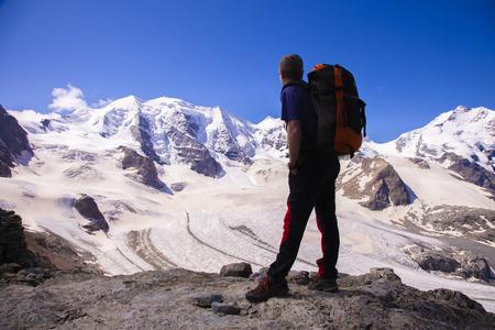 Lone trekker in Swiss mountains Standard-Bild