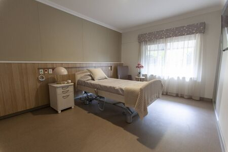 An empty bed in a nursing home.