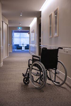 An empty wheelchair in an empty hallway, vertical frame. Standard-Bild - 139723877