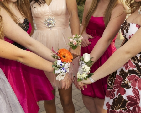 Hands in with wrist corsages