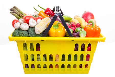 consumable: A yellow shopping basket full of fruits and vegetables isolated on white. Stock Photo