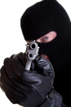 白い背景で撮影の拳銃で仮面の男。 写真素材