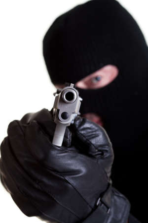 Masked man with handgun shot on white background.
