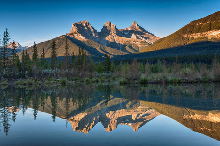 canmore: Three Sisters Reflection Stock Photo