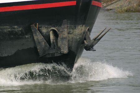 Front of a river barge with two anchors
