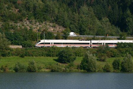 ICE train racing through the german countryside