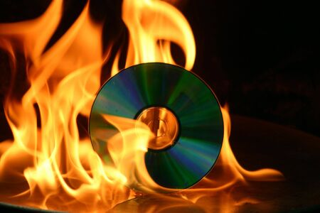 Burning of a CD - standing upright