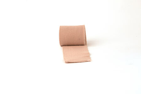 A roll of gauze bandage isolated on a white background. Imagens