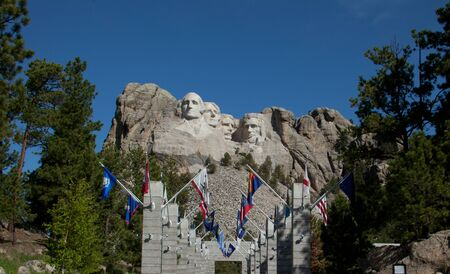 The Avenue of Flags with Mount Rushmore in the background.