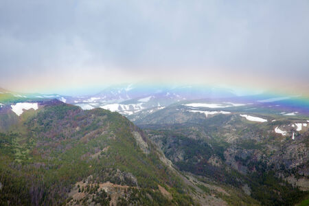 spanned: The Absaroka Mountains being spanned by a rainbow.