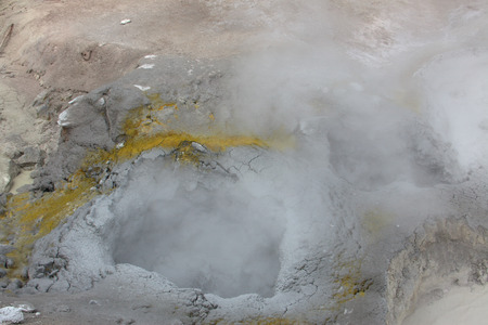 Steam coming from a muddy pit at Yellowstone National Park. Stock Photo