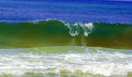 A wave crashing on the Emerald Coast. Banco de Imagens