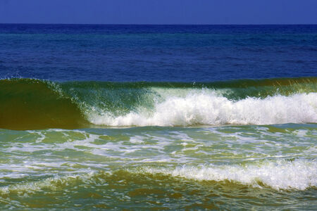 A green wave at the Emerald Coast.