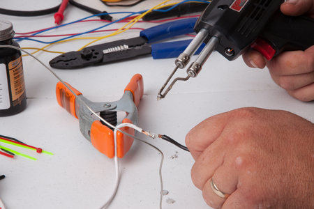 A bunch of tools used for soldering wires.