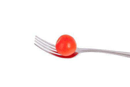 白い背景に分離されたフォークのチェリー トマト。 写真素材