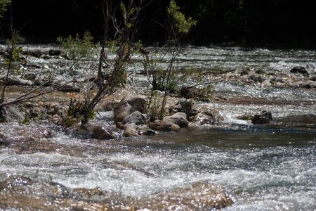 The water of the Black River flowing over rocks. Banco de Imagens