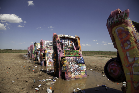 Graffiti cover cars at Cadillac Ranch in Amarillo, Texas on July 13, 2015.