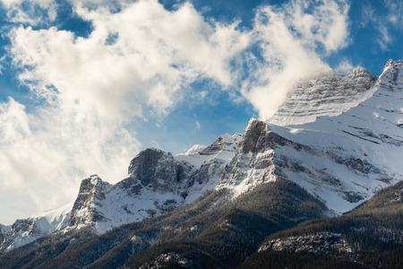 Snowy Mountaintop Among Clouds, Banff, Alberta Stock Photo