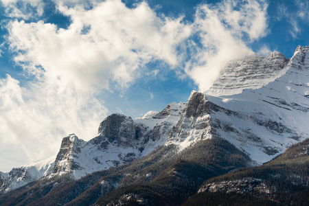 Snowy Mountaintop Among Clouds, Banff, Alberta Stock Photo