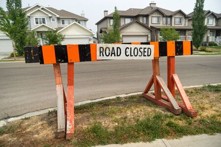 Road closed barrier on street curb Stock fotó