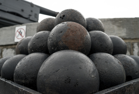 A stack of old cannon balls at a fort Stock Photo