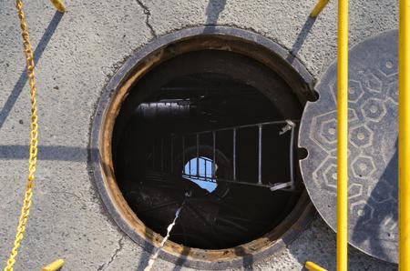 Open manhole on a city street