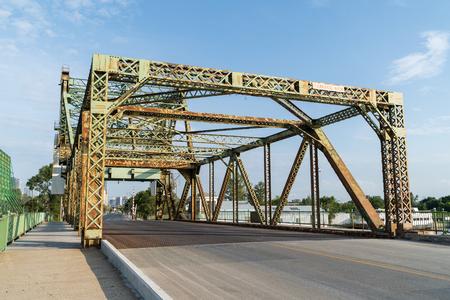 Cantilever bridge over waterway