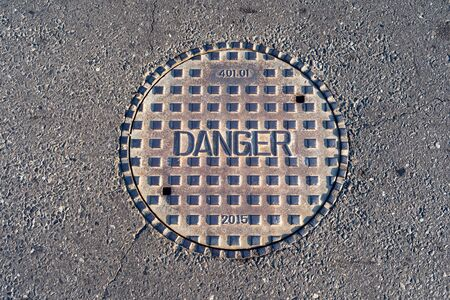 Closed manhole cover on a city street