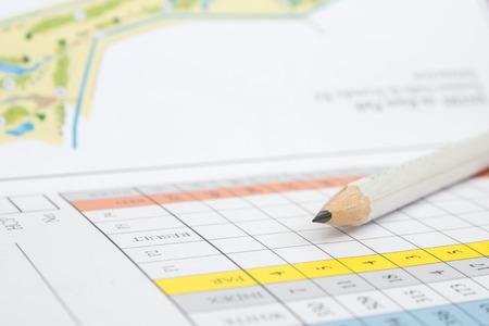 qualify: A pencil sitting on a golf score card