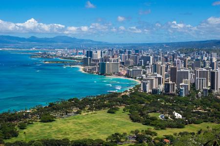 hawaii: The coastline of Waikiki Beach leading into Waikiki and Honolulu in Hawaii Stock Photo