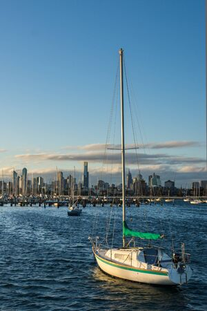 st kilda: Several Boats docked in front of the Melbourne Skyline Stock Photo