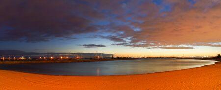 st kilda: A panoramic image of St Kilda beach at sunset