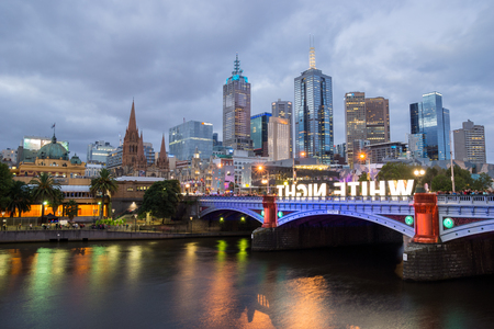 flinders: MELBOURNE, AUSTRALIA - FEBRUARY 22 2014: The Melbourne skyline, Flinders Street Station and the Princes Bridge are illuminated during the White Night Festival