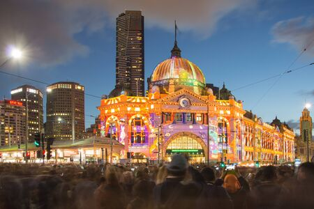 flinders: MELBOURNE, AUSTRALIA - FEBRUARY 22 2014: Thousands of people gather in front of Flinders Street Station during the White Night Festival Editorial