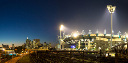 cricket sport: MELBOURNE, AUSTRALIA - SEPTEMBER 5 2014: The Melbourne skyline  and the Melbourne Cricket Ground at sunset