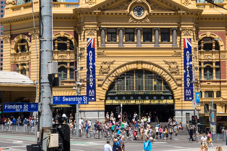 australia day: MELBOURNE, AUSTRALIA - JANUARY 26 2014: Flinders Street Station in Melbourne, Australia on Australia Day Editorial