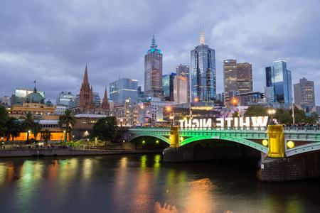 princes street: MELBOURNE, AUSTRALIA - FEBRUARY 22 2014: The Melbourne skyline, Flinders Street Station and the Princes Bridge are illuminated during the White Night Festival
