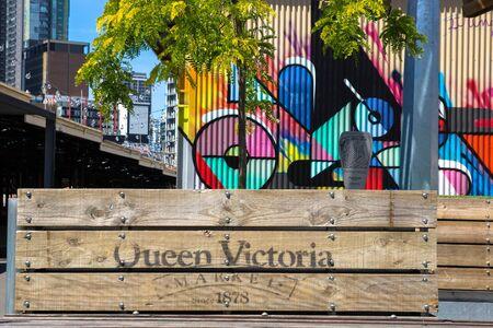 queen victoria: MELBOURNE, AUSTRALIA - 3 NOVEMBER 2014: Planter boxes and colorful artwork at Queen Victoria Markets in Melbourne, Australia.