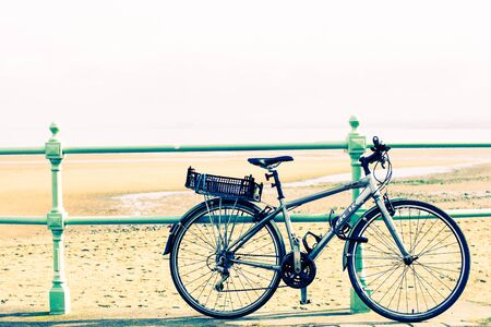 bollards: Bicycle Chained to Seafront Bollards Stock Photo