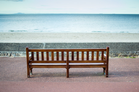 wooden bench: Wooden Bench Overlooking The Sea Stock Photo