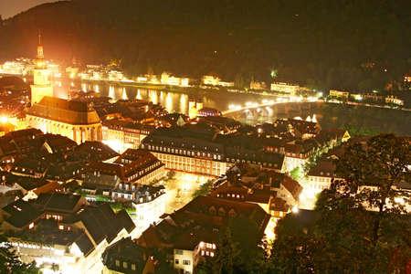 Old city panorama at night Фото со стока