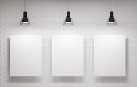 Drie posters op de witte bakstenen muur Stockfoto