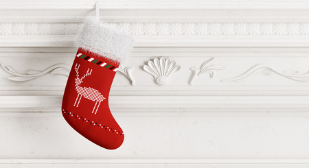 Red christmas stocking hanging on carved stone fireplace 3d rendering Foto de archivo