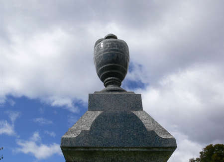 Clipping path of marble urn atop cemetery marker. Stock Photo