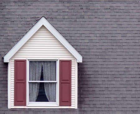 pitched roof: Cape cod style window with steeply pitched shingled roof background