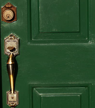 deadbolt: Detail of residential six panel front door with brass door handle and key lock Stock Photo