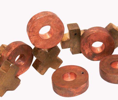double game: Brass and copper game pieces that double as jewelry adornments. Stock Photo