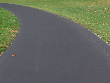 macadam: Left bend in paved park walking path