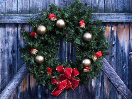 Christmas wreath on rustic wooden fence gate photo