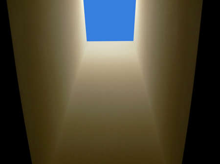 Looking upwards through a residential ceiling skylight